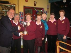 President Eugene Fannon presents Cup to Saturday League Winners