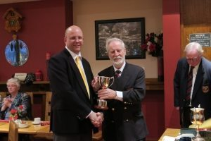 Trevor receives the Winners Cup from President Lorcan Finn